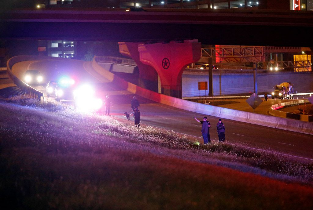 Police searched for evidence near the Texas Tech Police Department on Monday night after the fatal shooting of a Tech police officer. (Brad Tollefson/Lubbock Avalanche-Journal)