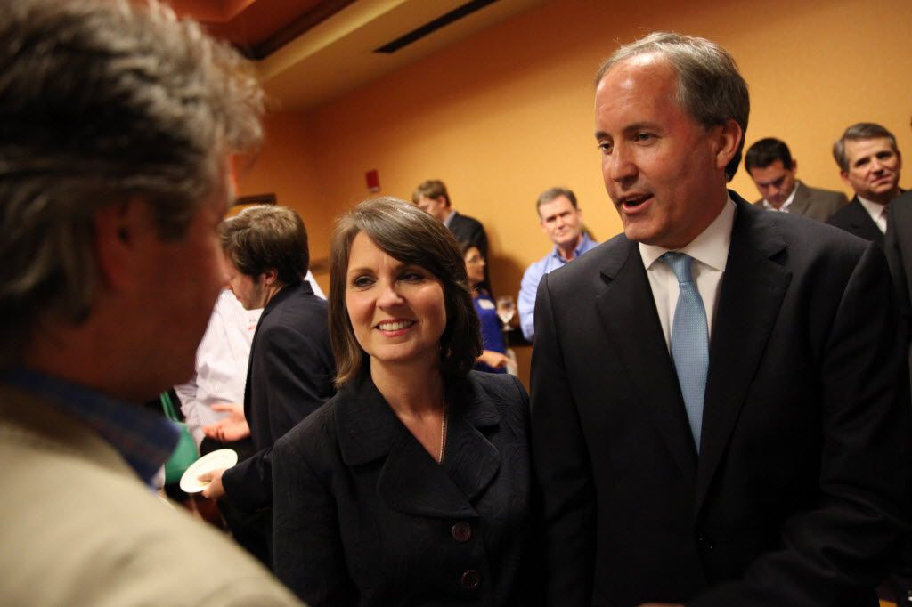 Ken Paxton (center) celebrates with his wife, Angela Paxton, after a guest announced he won the Republican runoff election for Texas attorney general against Dan Branch at a campaign watch party in Frisco on May 27, 2014.