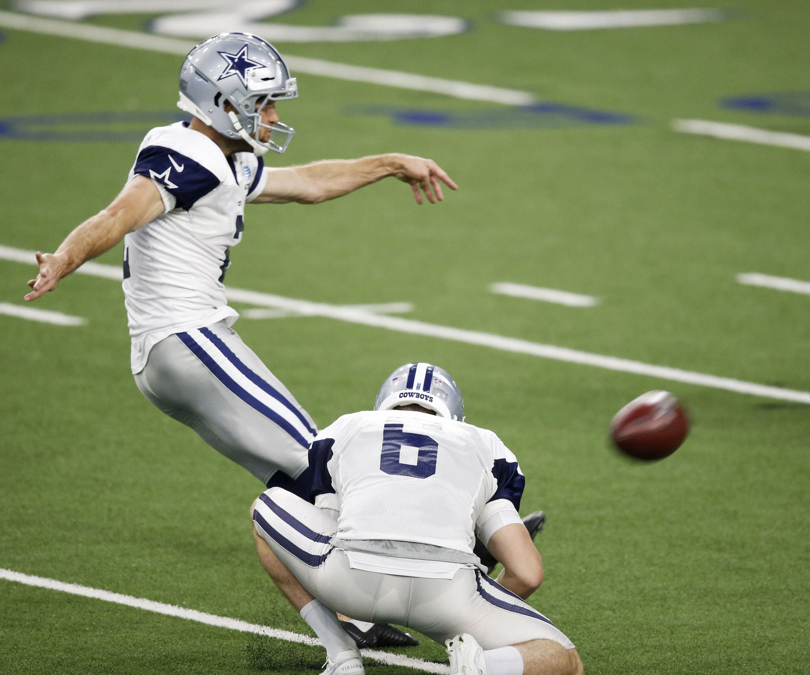 Dallas Cowboys place kicker Greg Zuerlein (2) attempts a field goal as Dallas Cowboys punter Chris Jones (6) held the ball during training camp at the Dallas Cowboys headquarters at The Star in Frisco, Texas on Tuesday, August 25, 2020. (Vernon Bryant/The Dallas Morning News)