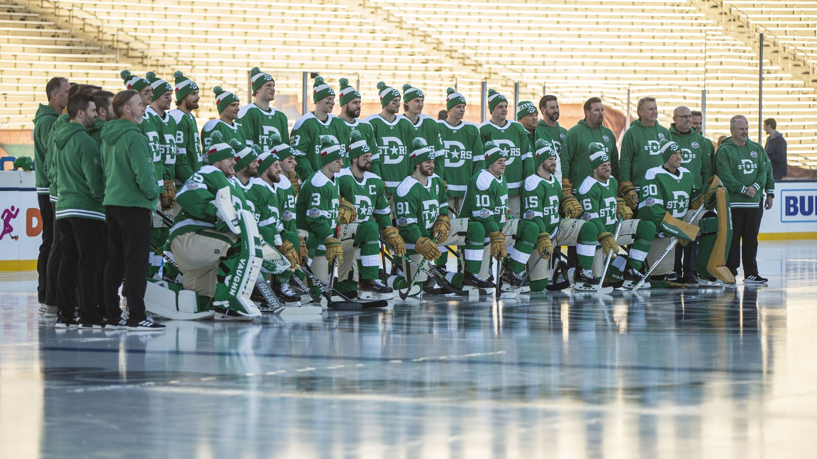 Dallas Stars players, coaches and personal pose for a group photo before practice leading up to the Winter Classic match against the Nashville Predators at the Cotton Bowl in Fair Park, Tuesday, December 31, 2019.