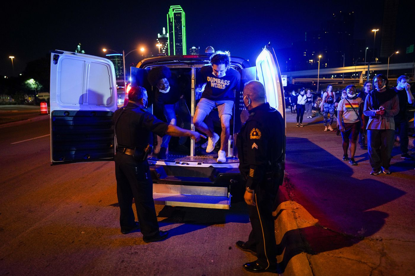Protesters are released outside the Frank Crowley Courthouse after being arrested on the Margaret Hunt Hill Bridge while demonstrating against police brutality on Monday, June 1, 2020, in Dallas. Protests continued Monday, a week after the death of George Floyd.