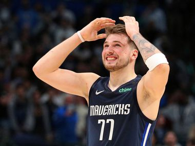 Dallas Mavericks forward Luka Doncic (77) reacts to a missed 3-point attempt by Tim Hardaway Jr. (11) that would have tied the game near the end of an NBA basketball game against the Los Angeles Clippers Tuesday, Jan. 21, 2020 in Dallas. (AP Photo/Richard W. Rodriguez)