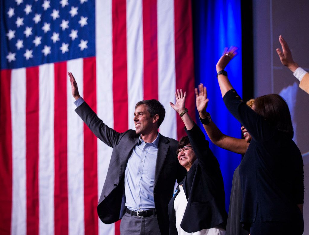 U.S. Representative Beto O'Rourke, gubernatorial candidate Lupe Valdez and other candidates wave on stage during the Texas Democratic Convention on Friday, June 22, 2018 at the Fort Worth Convention Center in Fort Worth. (Ashley Landis/The Dallas Morning News)