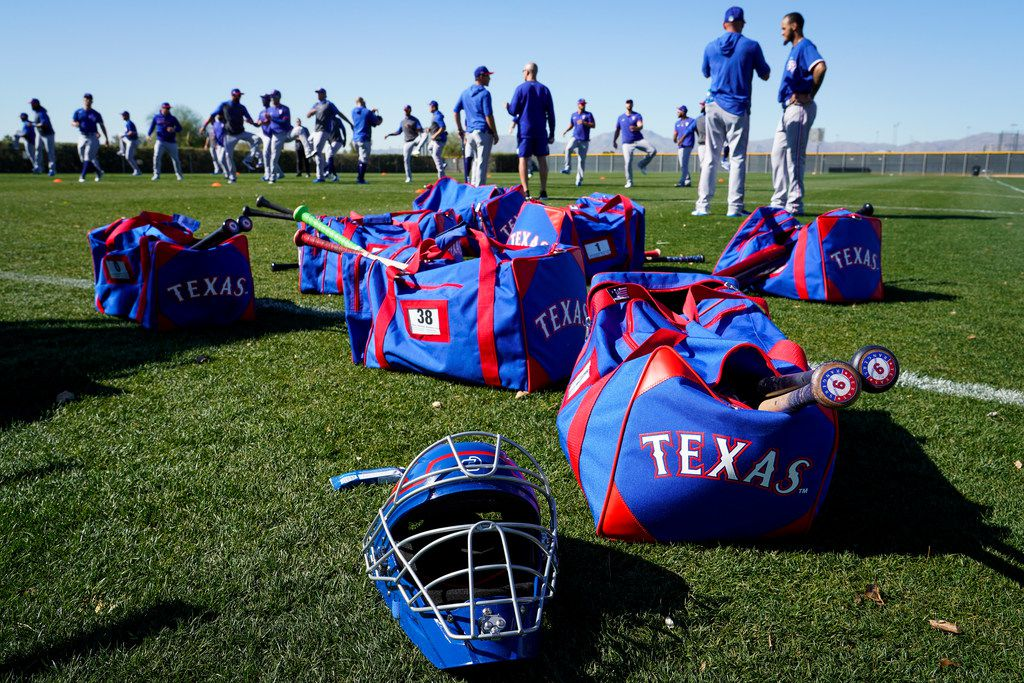 Texas Rangers players stretch during a spring training workout at the team's training facility on Thursday, Feb. 20, 2020, in Surprise, Ariz.