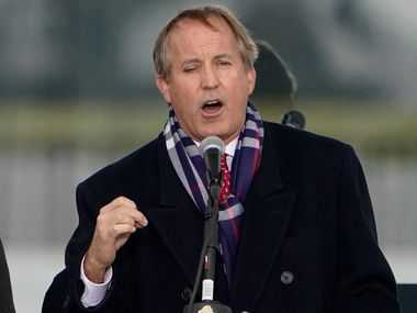 FILE - This Jan. 6, 2021 file photo, Texas Attorney General Ken Paxton speaks in Washington, at a rally in support of President Donald Trump.  In December, Paxton filed legal papers attempting to overturn the results of the presidential election based on unfounded claims of election fraud in four states that supported President Donald Trump in 2016 but elected Joe Biden president in 2020. The Republican attorneys general for 17 other states made legal filings supporting his effort, which was rejected by the U.S. Supreme Court.