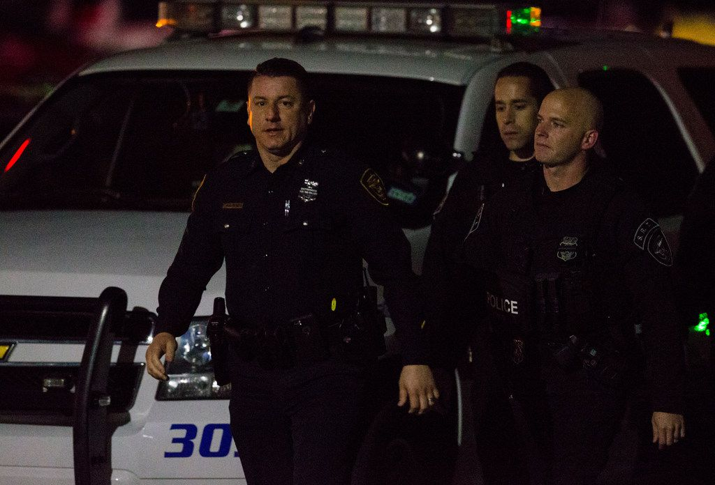 Police officers gather at the emergency room at Medical City Plano hospital in Plano, Texas after a Richardson, Texas police officer was shot and killed on Wednesday, February 7, 2018, at an apartment complex in Richardson.