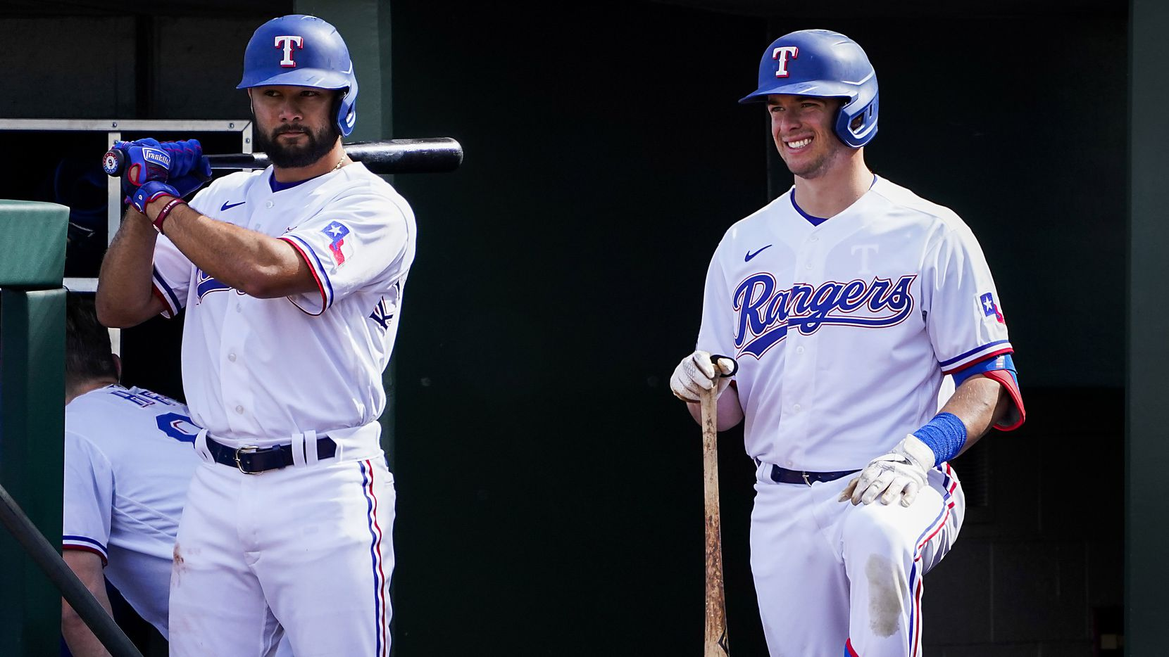Texas Rangers infielder Isiah Kiner-Falefa (left) and infielder/outfielder Nick Solak wait to bat during the fifth inning of a spring training game against the Chicago Cubs at Surprise Stadium on Thursday, Feb. 27, 2020, in Surprise, Ariz.