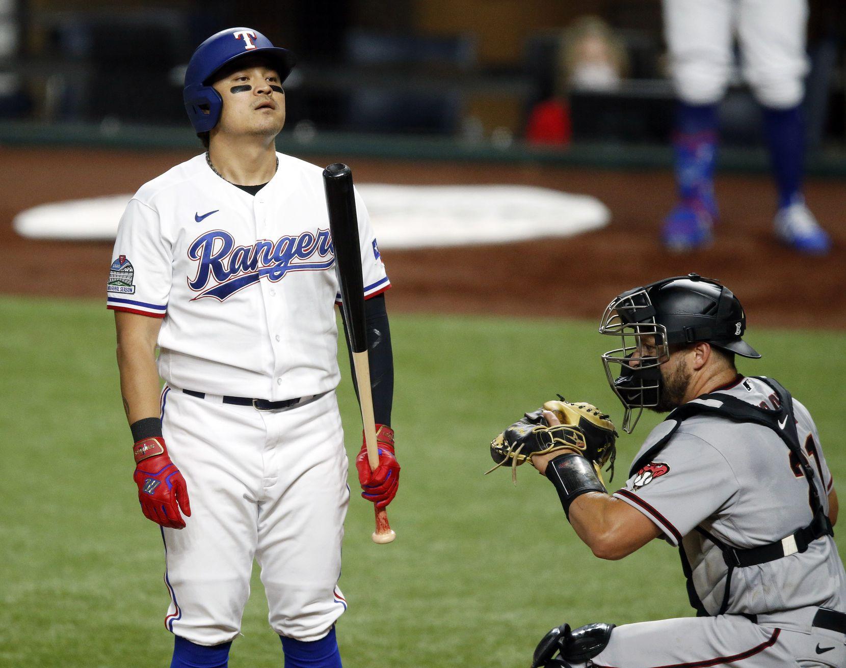 Texas Rangers left fielder Shin-Soo Choo (17) reacts to a called third strike to end the third inning against the Arizona Diamondbacks at Globe Life Field in Arlington, Texas, Tuesday, July 28, 2020. (Tom Fox/The Dallas Morning News)