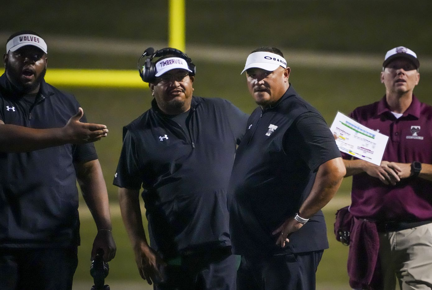Mansfield Timberview head coach James Brown (second from right) reacts to a call during the first half against Waco University in a high school football game at Waco ISD Stadium on Friday, Oct. 8, 2021, in Waco, Texas.