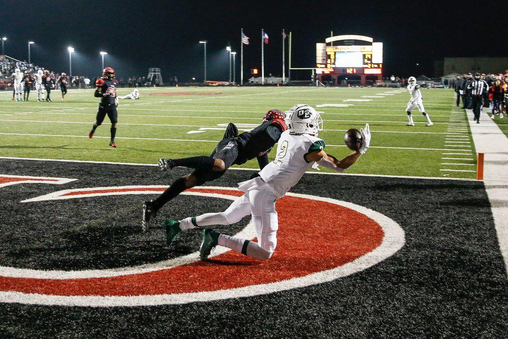 DeSoto wide receiver Lawrence Arnold (2) lands a touchdown pass over Cedar Hill cornerback Kenneth Kemp (4) during a high school football match up between Cedar Hill and DeSoto on Thursday, Nov. 7, 2019. (Ryan Michalesko/The Dallas Morning News)