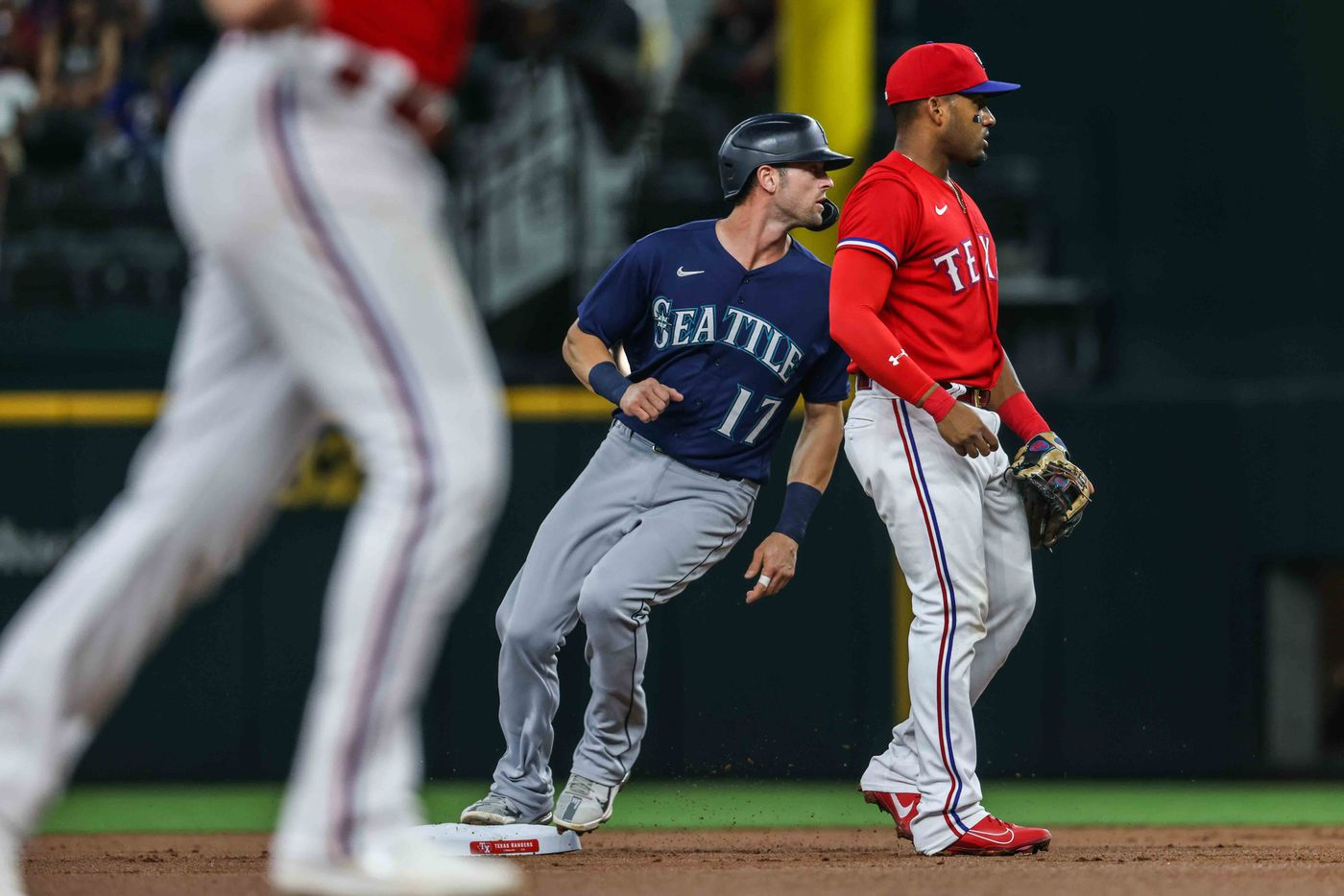 Seattle Mariners Mitch Haniger (17) reaches second base after Ty France (23) is out in first base during the first inning against the Texas Rangers at Globe Life Field in Arlington, Texas, Friday, July 30, 2021. (Lola Gomez/The Dallas Morning News)