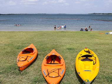 People spend the day at a beach at Collin Park in Lake Lavon, Wylie on Saturday, July 17, 2021. (Lola Gomez/The Dallas Morning News)