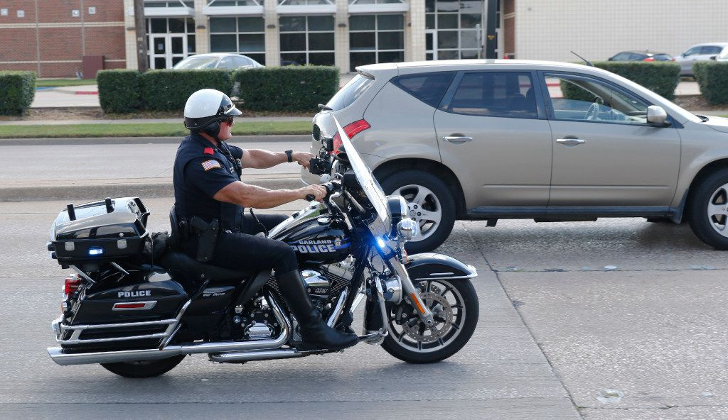 Garland police Officer Lanny Orman chases a motorist for texting on his phone while driving through a school zone at Handley Elementary.