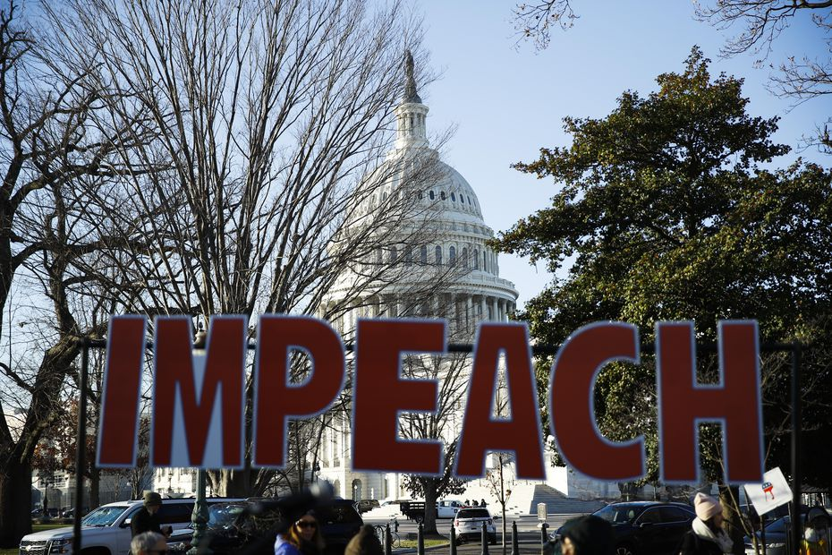 Protesters demonstrate as the House of Representatives begins debate on impeachment of President Donald Trump on Dec. 18, 2019.