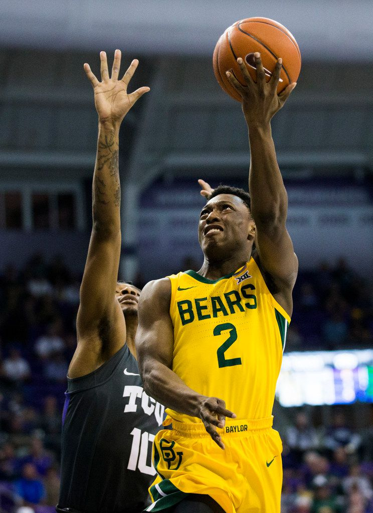 Baylor Bears guard Devonte Bandoo (2) takes a shot ahead of TCU Horned Frogs forward Diante Smith (10) during the first half of an NCAA mens basketball game between Baylor and TCU on Saturday, February 29, 2020 at Ed & Rae Schollmaier Arena on the TCU campus in Fort Worth. (Ashley Landis/The Dallas Morning News)