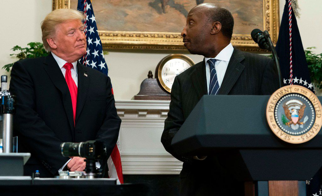 US President Donald Trump shakes hands with Ken Frazier (R), CEO of Merck, during the announcement of a a newly designed, Made in America pharmaceutical glass bottle jointly developed by Merck, Pfizer and Corning during a Made in America Week event in the Roosevelt Room of the White House in Washington, DC, July 20, 2017. / AFP PHOTO / SAUL LOEBSAUL LOEB/AFP/Getty Images