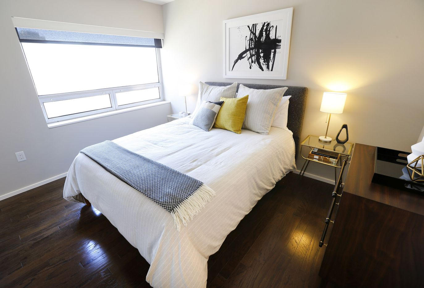 The bedroom of one-bedroom residence at the Statler Residences in downtown Dallas.