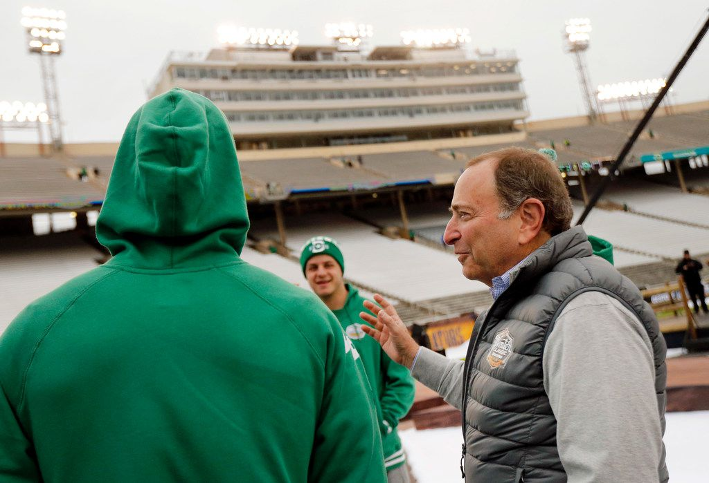 NHL Commissioner Gary Bettman (right) visits with Dallas Stars players prior to the outdoor NHL Winter Classic hockey game at the Cotton Bowl in Dallas, Wednesday, January 1, 2019. (Tom Fox/The Dallas Morning News)