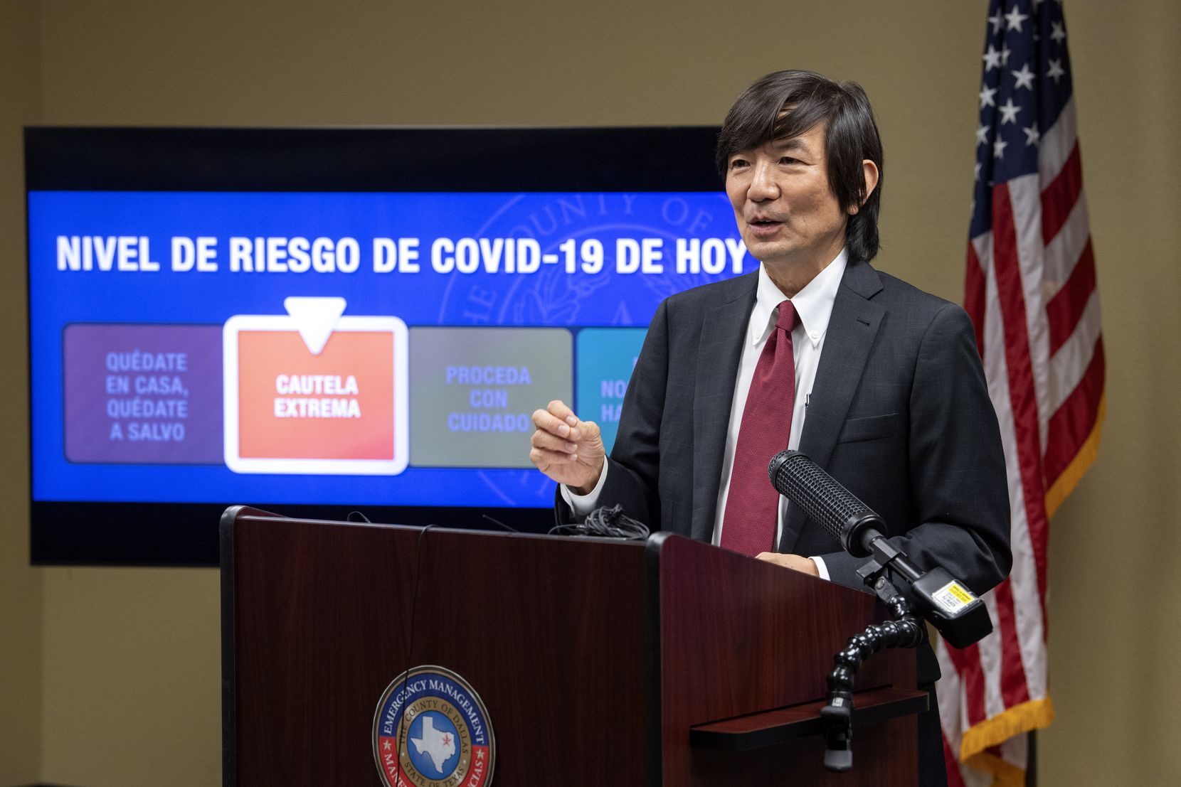 Dr. Philip Huang, Dallas County Health and Human Services director, discusses the county's decision to lower the COVID-19 risk level from red to orange during a news conference.