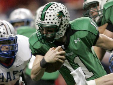 Southlake Carroll QB Riley Dodge (11) is tackled by Austin Westlake Mark Daniel (47) in the UIL Division I football state championship at the Alamodome in San Antonio, Texas Saturday December 23, 2006.