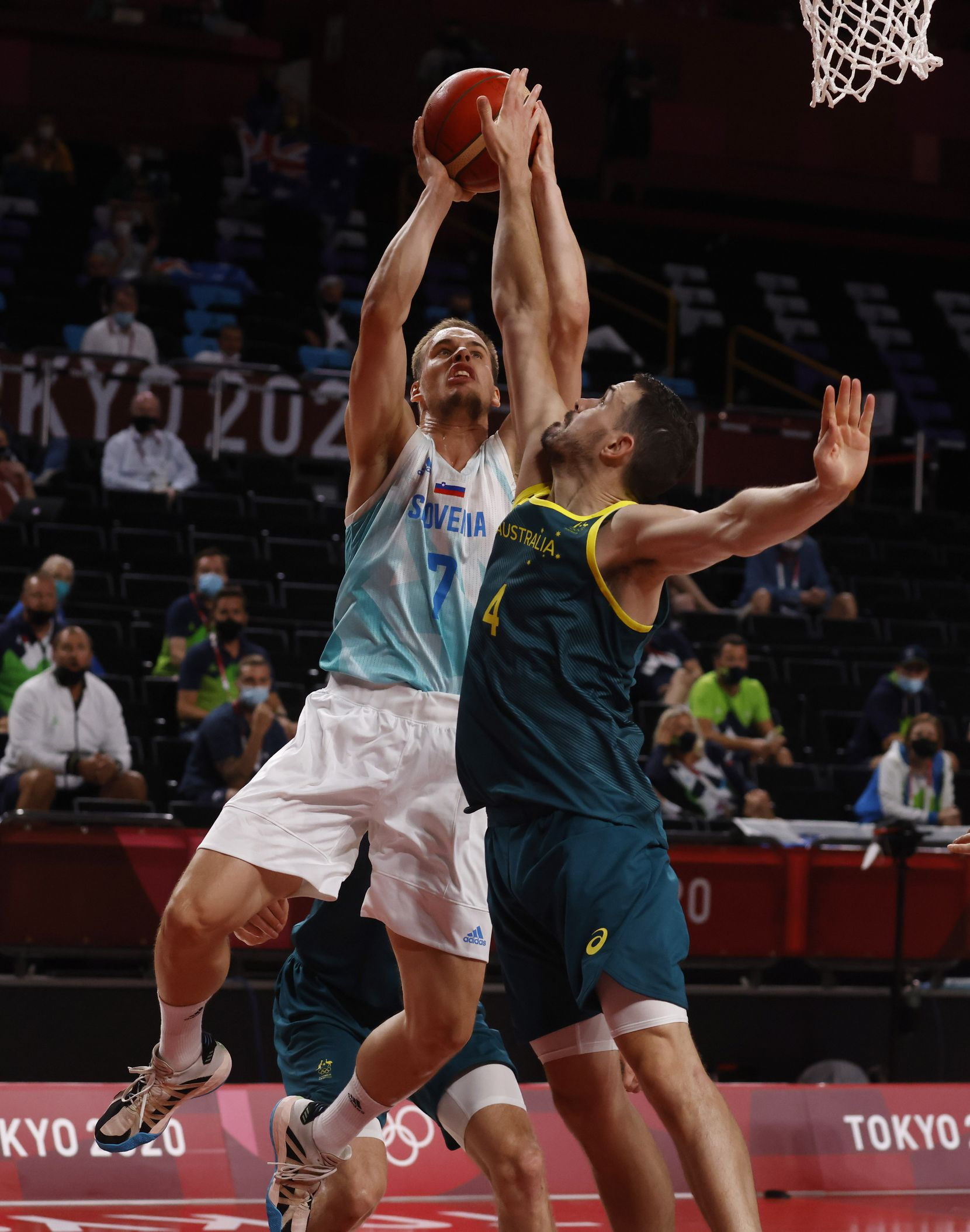 Slovenia's Klemen Prepelic (7) shoots over Australia's Chris Goulding (4) during the second quarter of play in the bronze medal basketball game at the postponed 2020 Tokyo Olympics at Saitama Super Arena, on Saturday, August 7, 2021, in Saitama, Japan. (Vernon Bryant/The Dallas Morning News)