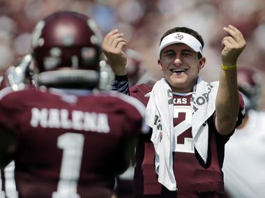 "Texas A&M's Johnny Manziel, right, celebrates a touchdown by teammate Ben Malena (1) during the first quarter of an NCAA college football game against Rice, Saturday,  Aug. 31, 2013, in College Station, Texas.  Manziel has been suspended for the first half of the team's game for what the school said was an ""inadvertent"" violation of NCAA rules by signing autographs. (AP Photo/Eric Gay) 04062014xPOINTS"