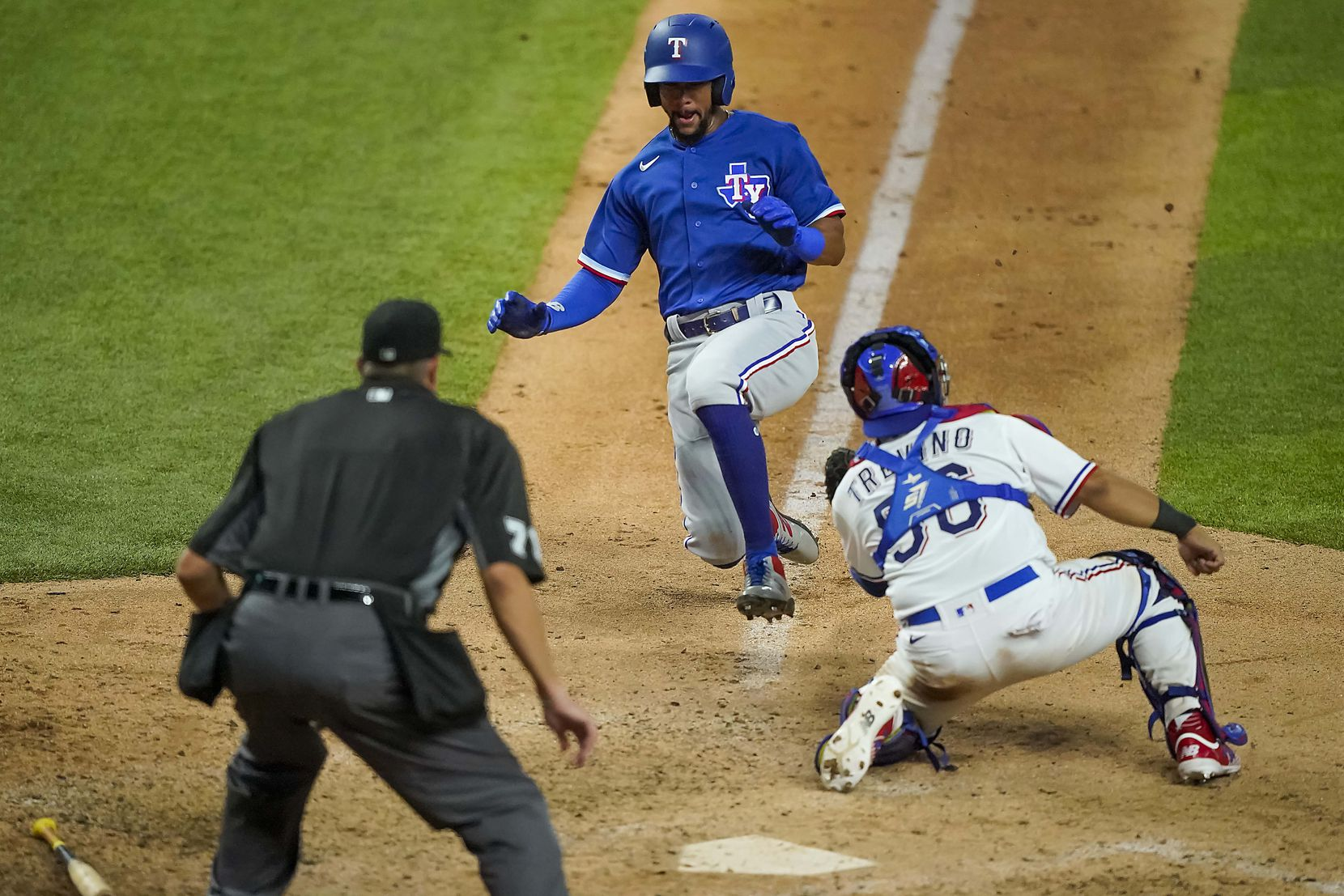 Leody Taveras is out at home trying to score from third on an infield grounder as catcher Jose Trevino waits with the tag during a Texas Rangers Summer Camp intrasquad game at Globe Life Field on Saturday, July 18, 2020.