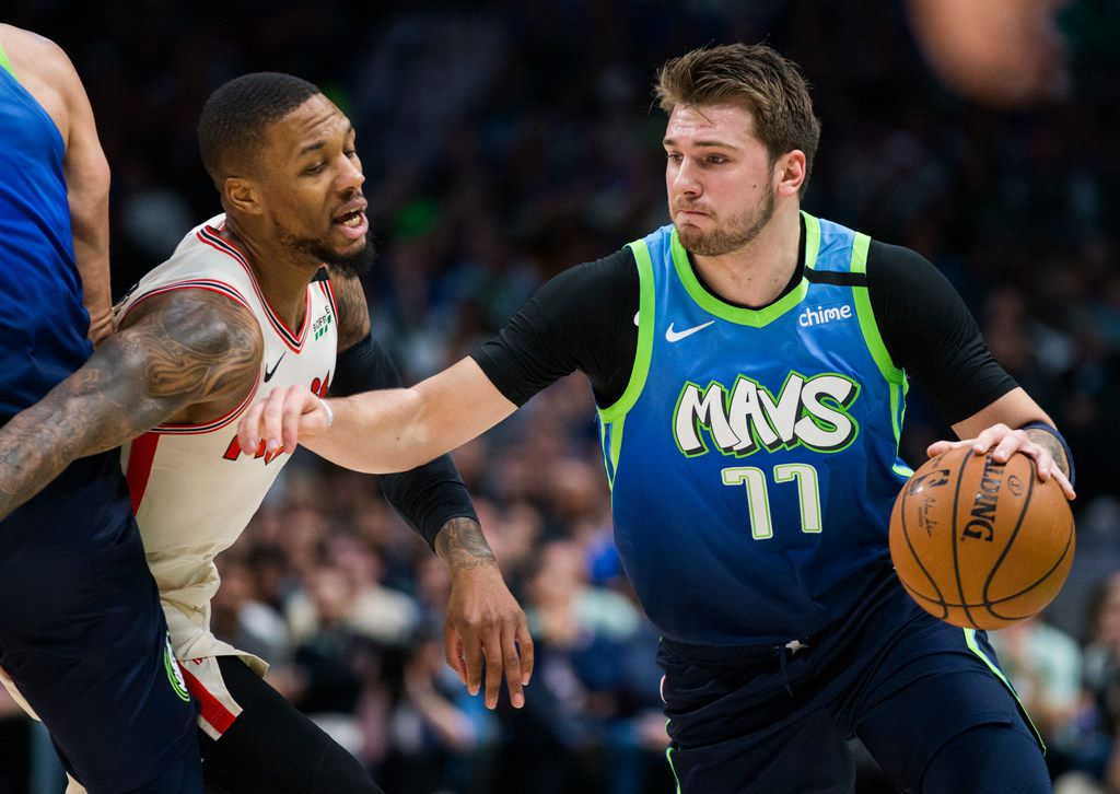 Dallas Mavericks forward Luka Doncic (77) is defended by Portland Trail Blazers guard Damian Lillard (0) during the first quarter of an NBA game between the Dallas Mavericks and the Portland Trail Blazers on Friday, January 17, 2020 at American Airlines Center in Dallas. (Ashley Landis/The Dallas Morning News)