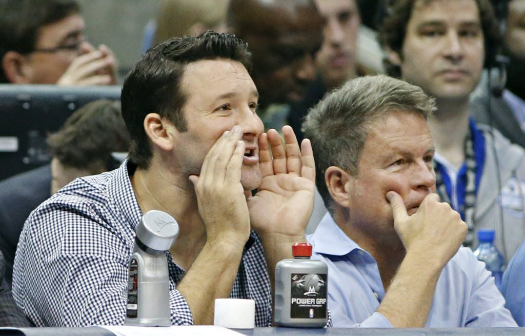 Dallas Cowboys quarterback Tony Romo watches action from courtside seats during the second half of the Dallas Mavericks' 109-106 loss to the Oklahoma City Thunder Friday, January 22, 2016 at the American Airlines Center in Dallas. (G.J. McCarthy/The Dallas Morning News)