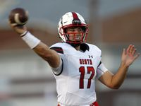 Rockwall Heath quarterback Josh Hoover (17) passes downfield during first half action against Red Oak. The two teams played their non-district football game at Billy Goodloe Stadium on the campus of Red Oak High School in Red Oak on September 10, 2021.