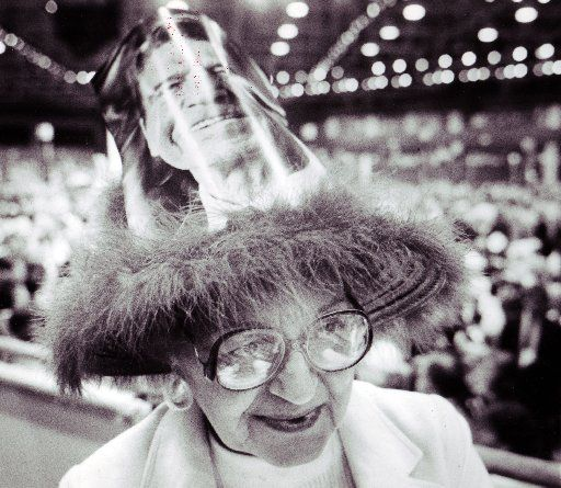 Elaine Thomas of Cleveland wears a festive hat on the convention floor.