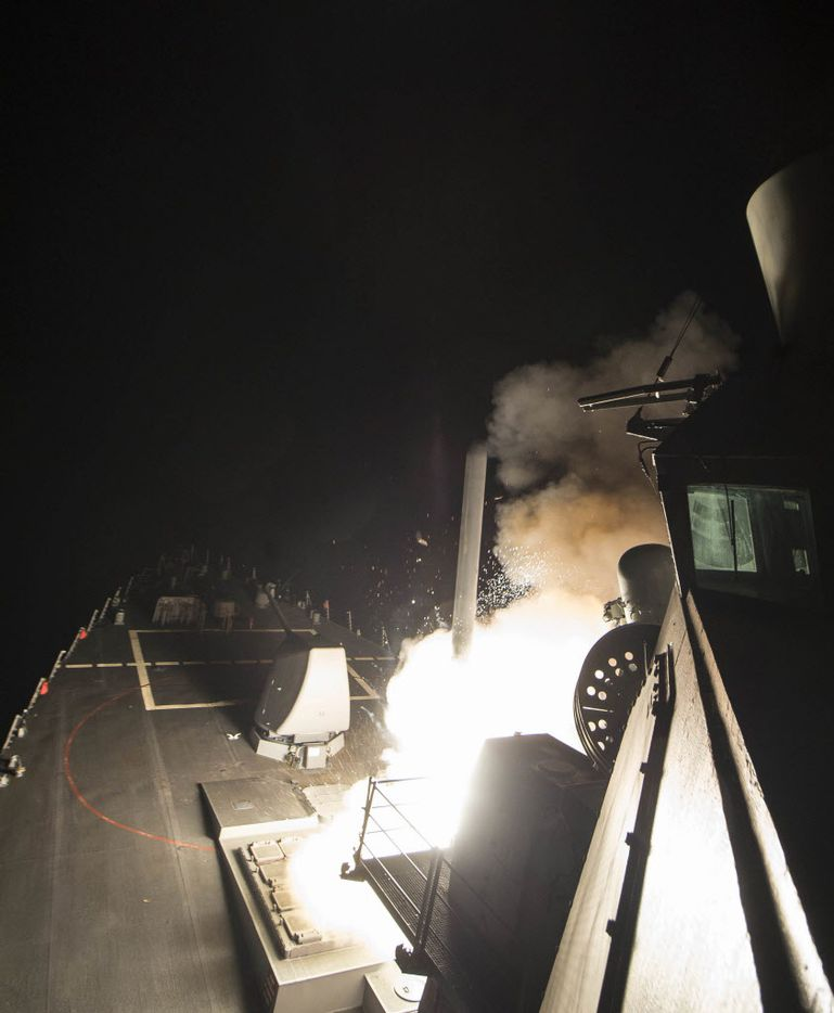 In this image provided by the U.S. Navy, the USS Ross (DDG 71) fires a tomahawk land attack missile Friday, April 7, 2017, from the Mediterranean Sea. (Mass Communication Specialist 3rd Class Robert S. Price/U.S. Navy via AP)
