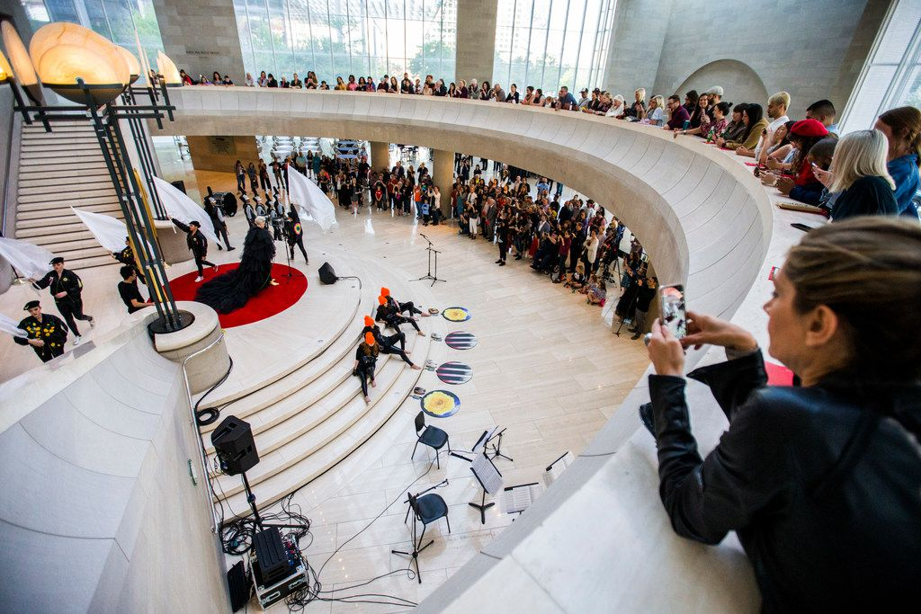 """Musician Sarah Jaffe performs during a pop-up performance entitled """"Eyes as Bright as Diamonds"""" to kick off the Soluna International Music & Arts Festival on Wednesday, April 11, 2018 at the Morton H. Meyerson Symphony Center in Dallas. The performance brings together New York artist Jen Ray, musician Sarah Jaffe and several Dallas performers. (Ashley Landis/The Dallas Morning News)"""