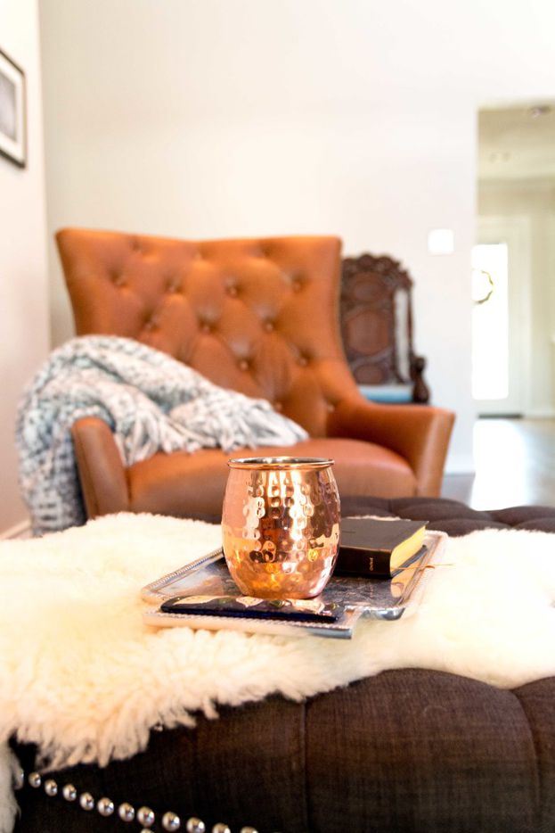 One easy way to cozy up a room is by layering in sheep skin, says Tara Lenney.