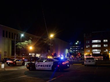 Police secure the area near the West End District in Dallas where a suspect engaged in gunfire with an El Centro officer Nov. 5.