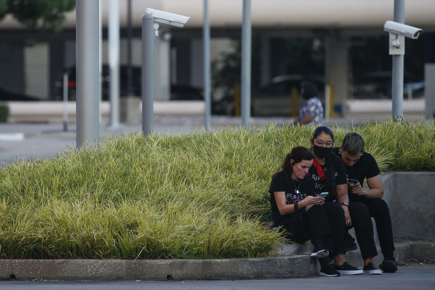 People wait outside of Galleria Mall, where a shooting was reported Tuesday, June 16, 2020 in Dallas.