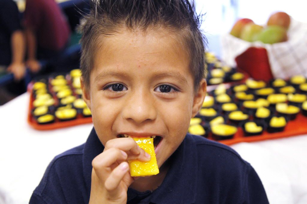 Gabriel Padron samples a piece of mango with his classmates at Brandenburg Elementary School on Friday, September 27, 2013. Brandenburg was one of many Irving ISD schools that tried mango at lunch for the first time. The program targets low income students who may not get the nutrition they need at home. (David Woo/The Dallas Morning News)