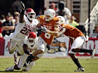 FILE - Texas wide receiver Jordan Shipley (8) tries to break away from Oklahoma defenders Keenan Clayton (22) and Dominique Franks in the second half of Texas' 16-13 win Saturday, Oct. 17, 2009, at the Cotton Bowl in Dallas.