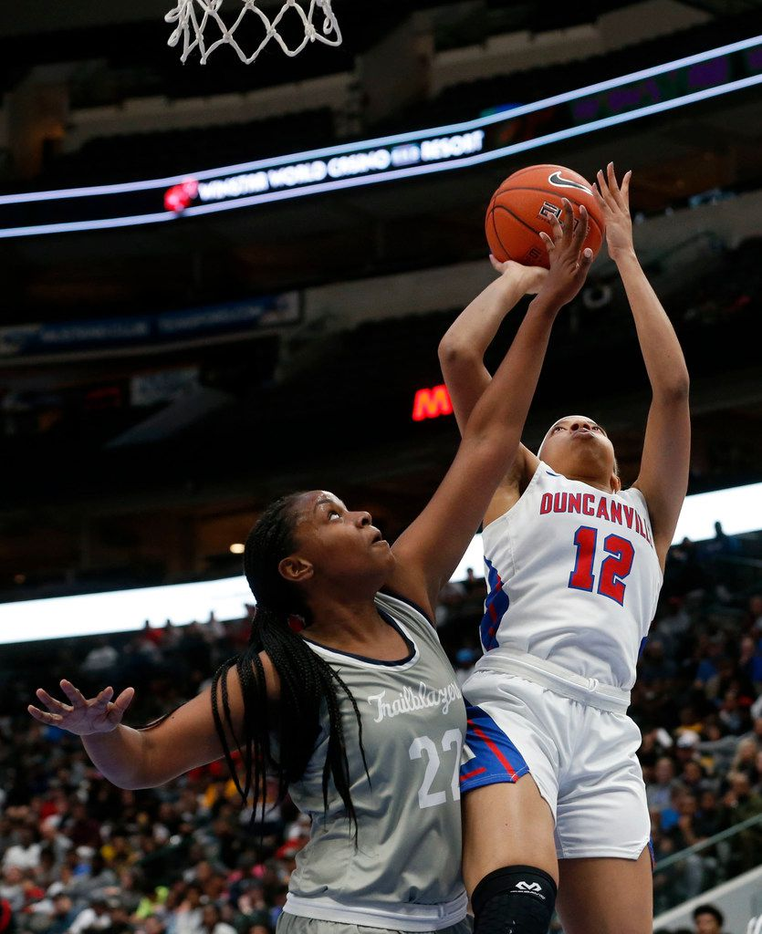 Duncaville's Zaria Rufus (12) shoots over Sierra Canyon's Theresa Berry (22) during their girls high school basketball game during the Thanksgiving Hoopfest in Dallas, Tx, Saturday, Nov. 30, 2019. (Michael Ainsworth)