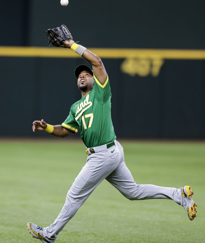 Oakland Athletics shortstop Elvis Andrus (17) catches a fly out hit by Texas Rangers' Willie Calhoun (5) during the third inning of a baseball game in Arlington, Monday, June 21, 2021. (Brandon Wade/Special Contributor)