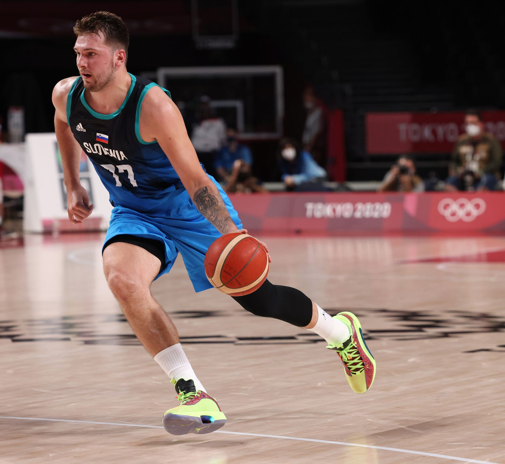 Slovenia's Luka Doncic (77)  drives up the court in the first half of play against Argentina during the postponed 2020 Tokyo Olympics at Saitama Super Arena on Monday, July 26, 2021, in Saitama, Japan. Slovenia defeated Argentina 118-100. (Vernon Bryant/The Dallas Morning News)
