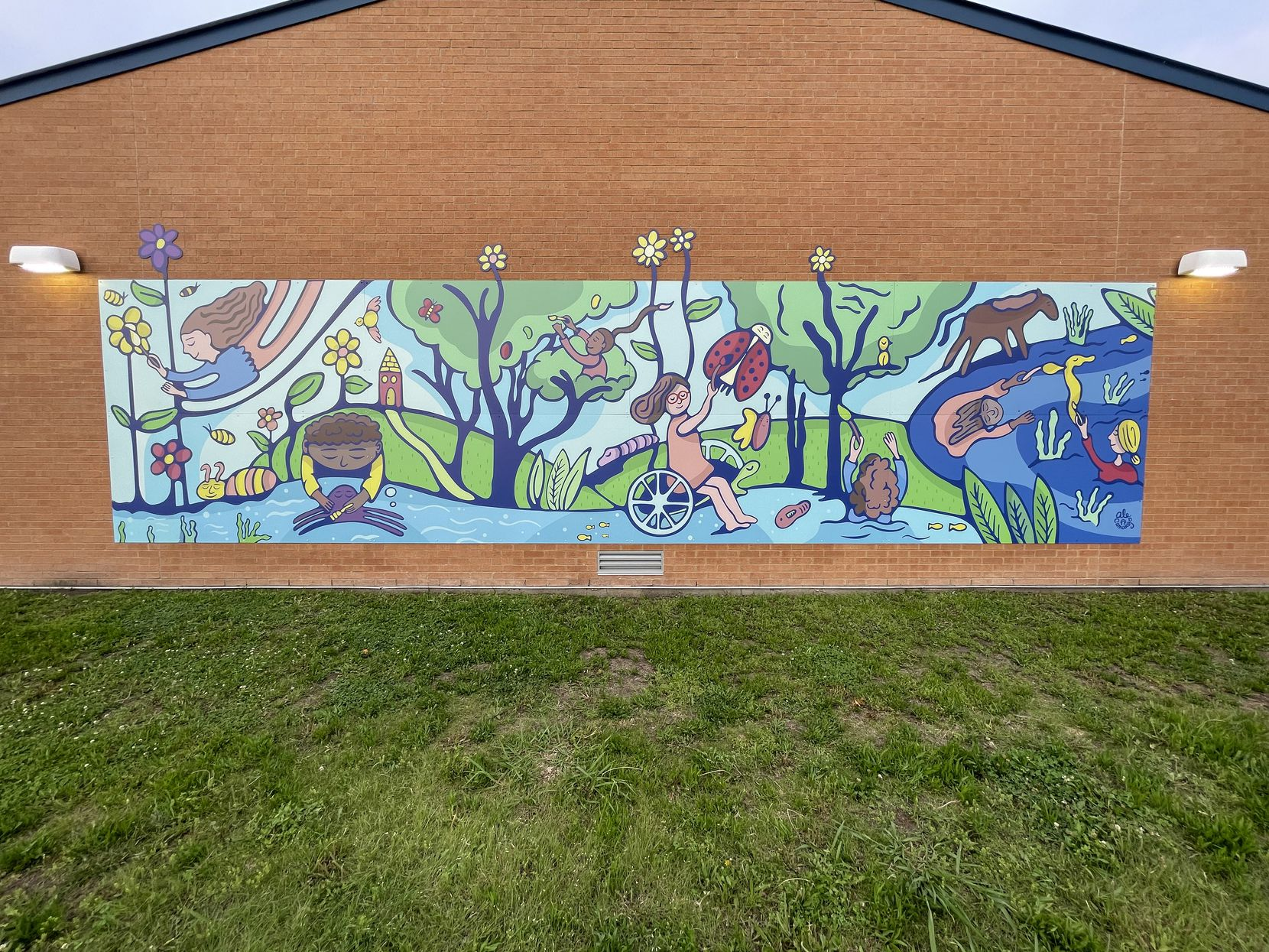 The mural at DISD's Burnett Elementary, by artist Alejandra Camargo, is dedicated to Virginia Escalante, a devoted school volunteer and PTA treasurer who died of the coronavirus. At the center of the fantastical rendering of children climbing out of clouds and trees is an image of the smiling Escalante.