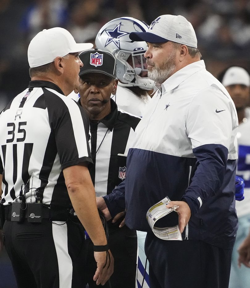 Dallas Cowboys head coach Mike McCarthy talks to referee John Hussey during the first half of a preseason NFL football game at AT&T Stadium on Sunday, Aug. 29, 2021, in Arlington. (Smiley N. Pool/The Dallas Morning News)