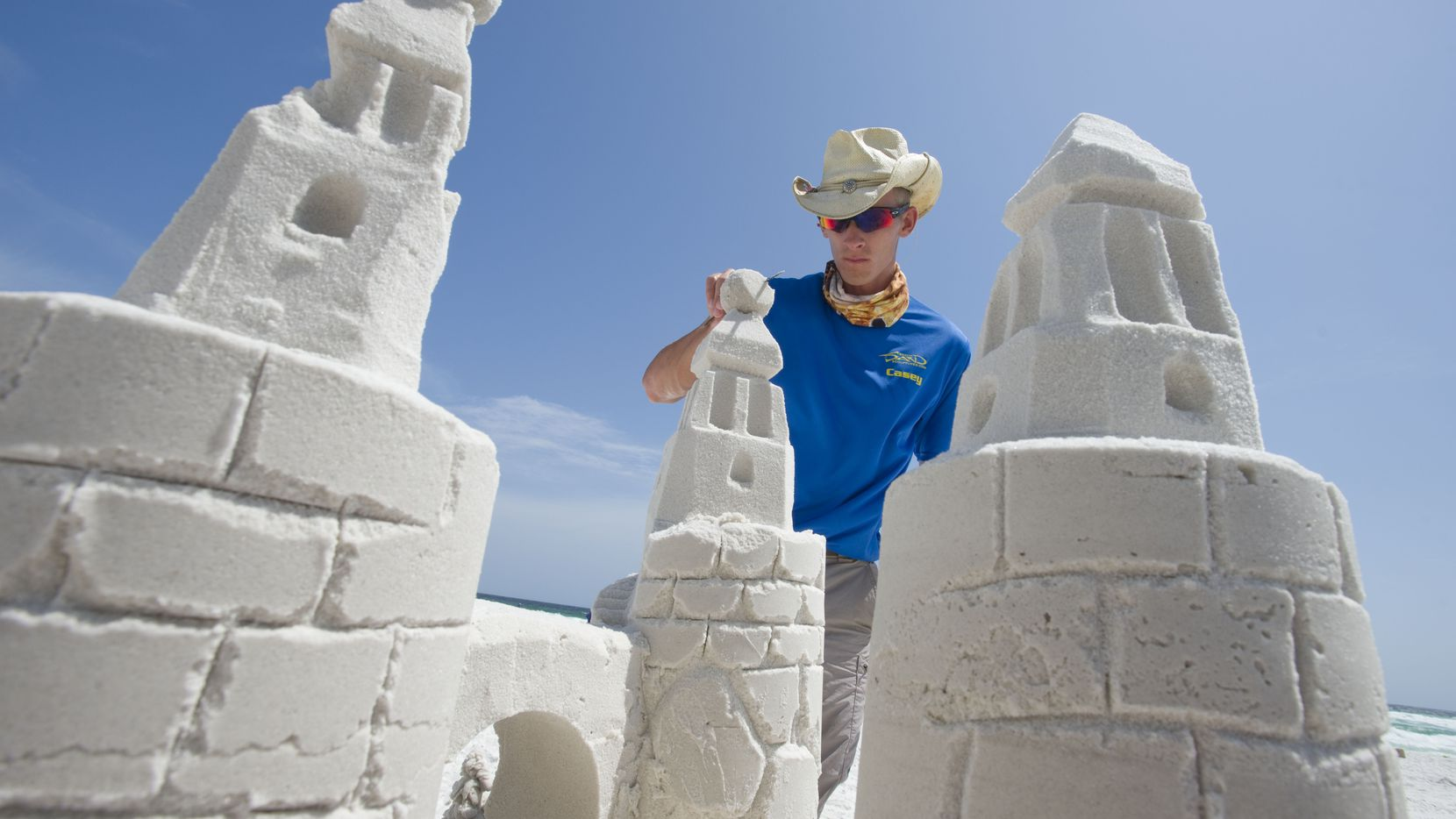 Casey Fabianski with Beach Sand Sculptures puts the finishing touches on a sand castle at the beach in Destin, Florida on Wednesday, June 11, 2014. (AP Photo/Northwest Florida Daily News, Devon Ravine)