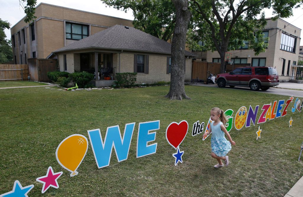 Gemma Franco, 6, runs in front of Jesus Gonzalez' current house next to the school where he works. He is having to relocate because it is on campus at University Park Elementary School and is being torn down in Dallas on May 18, 2017.