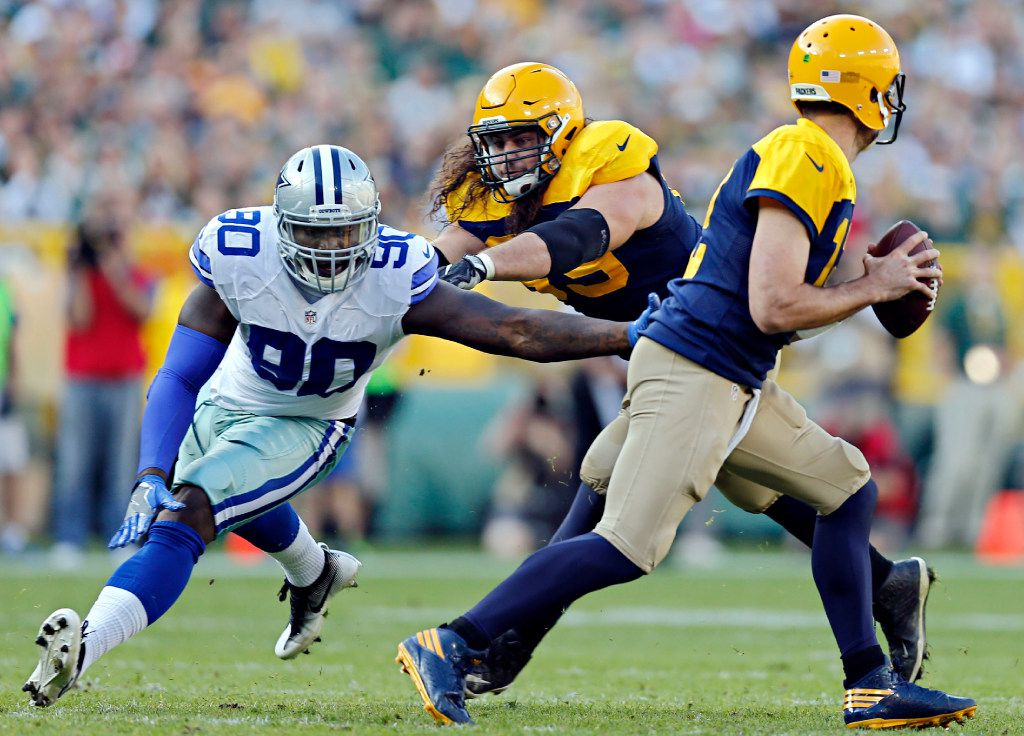Dallas Cowboys defensive end Demarcus Lawrence (90) pressures Green Bay Packers quarterback Aaron Rodgers during the first half of their game Sunday, October 16, 2016 at Lambeau Field in Green Bay, Wis. (G.J. McCarthy/The Dallas Morning News)