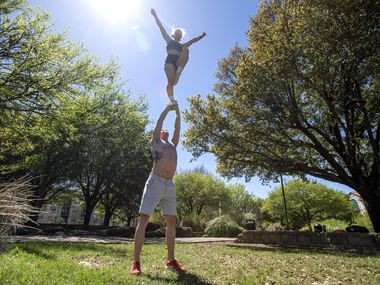 Landyn Gage, 20, and Caroline Perry, 19, both college cheerleaders back home because of the coronavirus, practice on Wednesday, March 25, 2020 at Central Park in Frisco, TX.