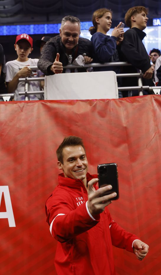 Sam Mikulak takes a photo with a fans camera after he was announced as a member of the U.S. mens olympic team during day 2 of the men's 2021 U.S. Olympic Trials at America's Center on Saturday, June 26, 2021 in St Louis, Missouri.(Vernon Bryant/The Dallas Morning News)