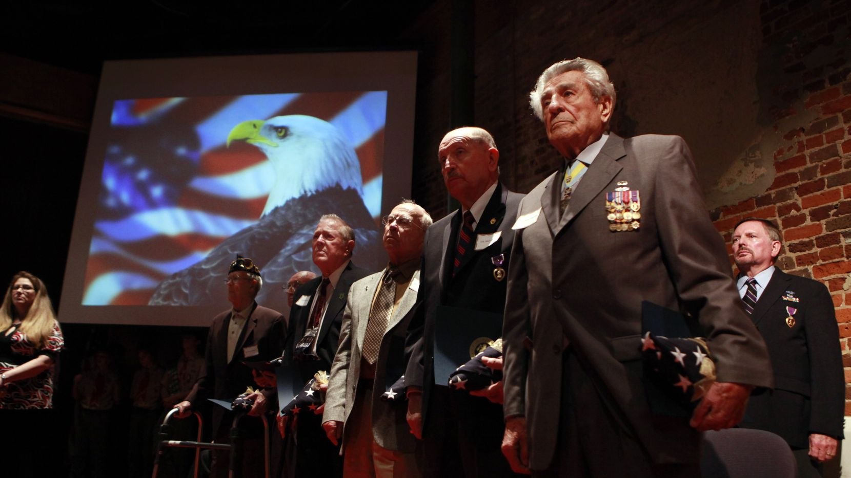 World War ll veteran James Megellas (front right) and other Purple Heart recipients, stand during a Purple Heart Recognition Ceremony hosted by Congressman Kenny Marchant, in Grapevine, Texas on in November, 2009.