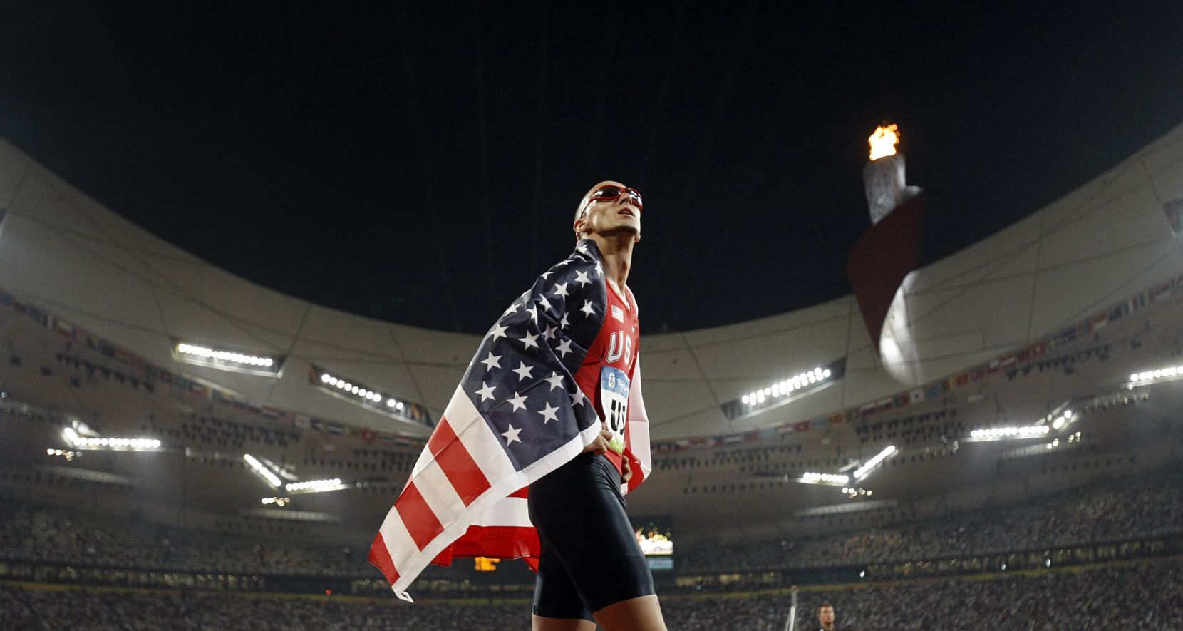 From 2008: U.S. Men's 4x400M Relay team member Jeremy Wariner watches the replay of his race on the National Stadium video board after his team won the gold medal, Saturday, August 23, 2008.